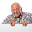 Senior man with a blank board — Stock Photo #13359257