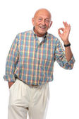 Senior man shows OK sign — Stock Photo