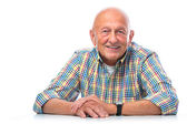 Portrait of a happy senior man smiling — Stock Photo