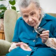 Senior woman counting money — Foto de Stock