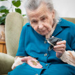 Senior womcounting money — Stock Photo #15682555