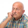 Stock Photo: Portrait of a thoughtful senior