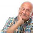 Portrait of a happy senior man smiling — Stock Photo #15682723