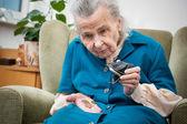Senior woman counting money — Stock Photo