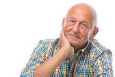 Portrait of a happy senior man smiling — Stock Photo