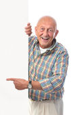 Happy smiling senior man holds a blank board — Stock Photo