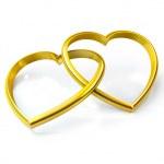 Heart shaped golden rings — Stock Photo