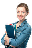 Young student girl with exercise books — Stock Photo