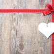 Red ribbon and bow with heart - Stock Photo