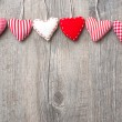 Red hearts hanging over wood background — 图库照片