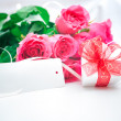 Roses and gift box with a card - Stock Photo