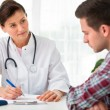 Doctor talking to patient — Stock Photo #20134333