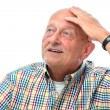 Senior man looking up - Stock Photo