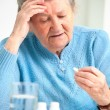 Stock Photo: Senior woman taking her medicine