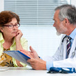 Doctor talking to his female patient — Stock Photo #29287953