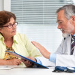 Doctor talking to his female patient — Stock Photo #29654671