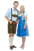 Bavarian couple in dirndl — Stock Photo
