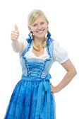 Girl in dirndl holding thumbs up — Stock Photo