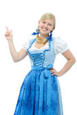 Girl in dirndl points her finger upwards — Stock Photo