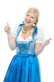 Girl in oktoberfest dirndl shows thumbs up — Stock Photo