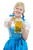 Girl in Oktoberfest dirndl holds Oktoberfest beer stein — Stock Photo