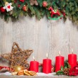 Foto Stock: Four advent candles burning