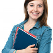 Stock Photo: Young student girl with exercise books