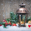 Christmas lantern in the snow — Stockfoto