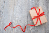 Gift box with red bow — Stock Photo