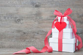 Stack of gift boxes with ribbon and bow — Stock Photo
