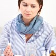 Sick young woman taking medicine — Stock Photo