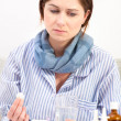 Stock Photo: Sick young womtaking medicine