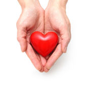Heart at the human hands — Stock Photo