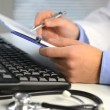 Doctor hands typing on keyboard — Stock Video #34619473