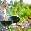 Family having a barbecue party — Stock Photo #34771935