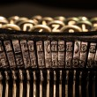 Close-up of old typewriter letter and symbol keys — Stockfoto