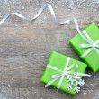 Gift boxes with bow and snowflakes — Stock Photo