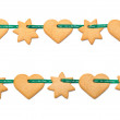Christmas cookies tied with green ribbon — Stock Photo