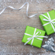 Gift boxes with bow and snowflakes — Stock Photo #36662095