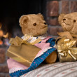 Vintage teddy bears  in front of fireplace — Stock Photo