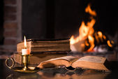 Bible with a burning candle — Stock Photo