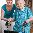 Senior woman with home caregiver — 图库照片
