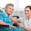 Senior woman with home caregiver — Photo