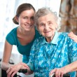 Senior woman with home caregiver — Stok fotoğraf
