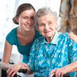 Senior woman with home caregiver — Стоковое фото
