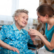 Foto de Stock  : Senior woman with home caregiver