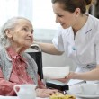 Stock Photo: Senior womwith home caregiver