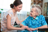 Senior woman with home caregiver — Stock Photo
