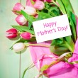 Bouquet of tulips and card — Stock Photo #39334019
