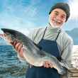 Fisher holding a big atlantic salmon fish — Stock Photo #39334161